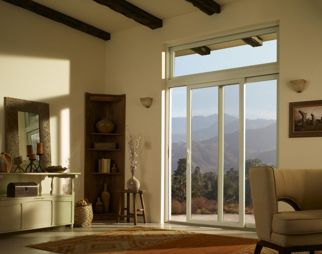 Living room with large sliding door with mountains outside