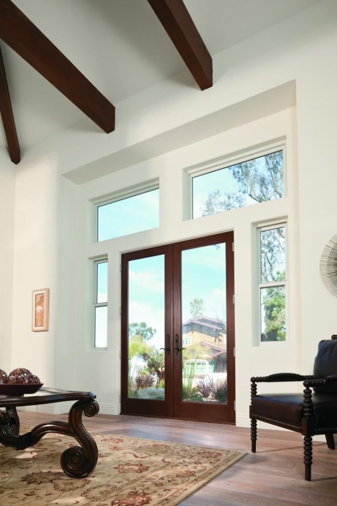 Living room with dark wood hinged patio door