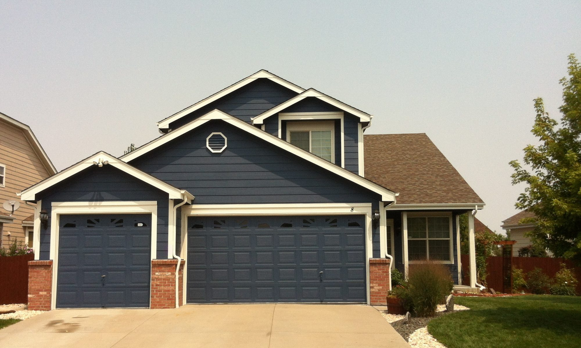 Dark Blue House And Garage