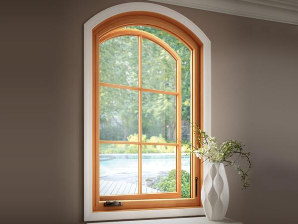 Natural wood arch window