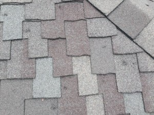 Hail Damage Roof Repair. Close Up Of Hail Damage To Shingles