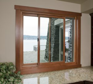 Natural wood sliding door looking out to lake