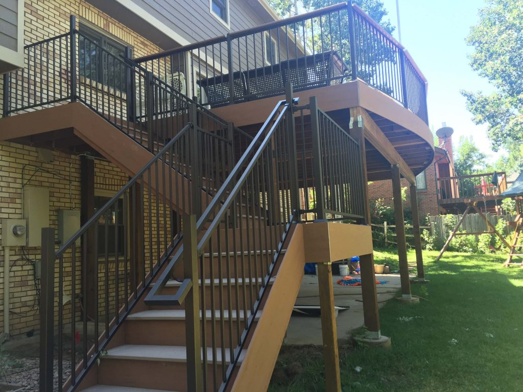 Custom brown second story deck with custom metal railing and stairs