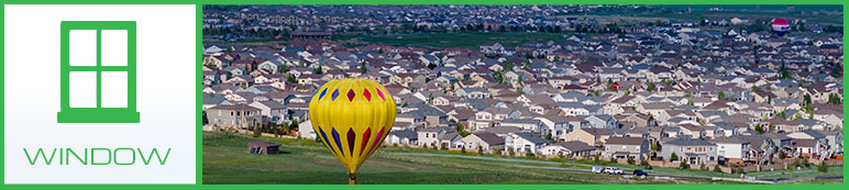 Large Colorado Neighborhood with hot air balloon in foreground