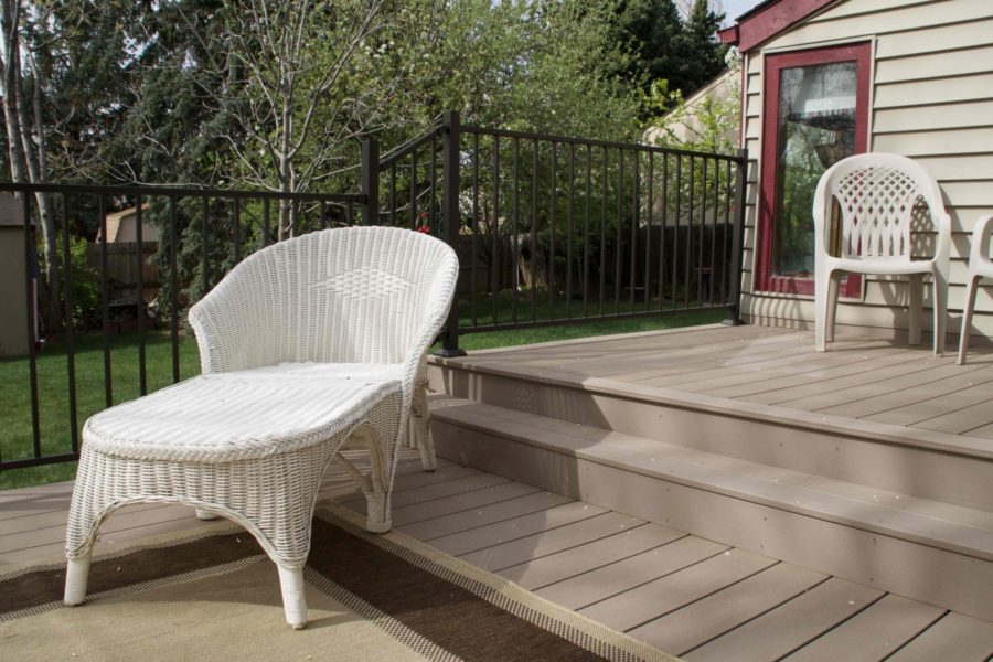 Close up of light brown wood patio with metal rails