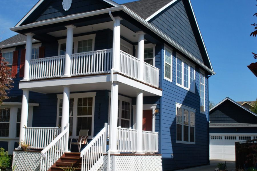 Bright blue house with white front porch