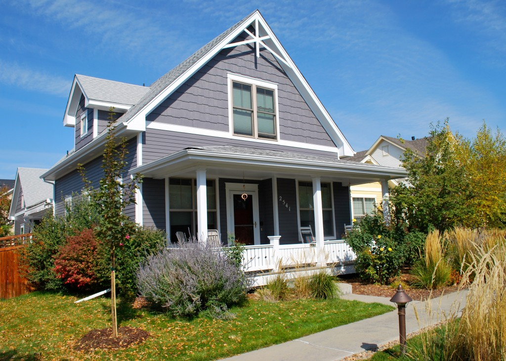 Dark Grey House With White Accents And Front Porch Vivax