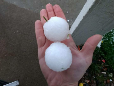 Baseball size hail in hand