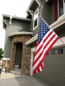 Stone front entrance to home with American flag