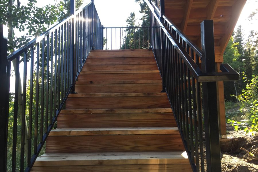 Natural wood stairway with metal rails